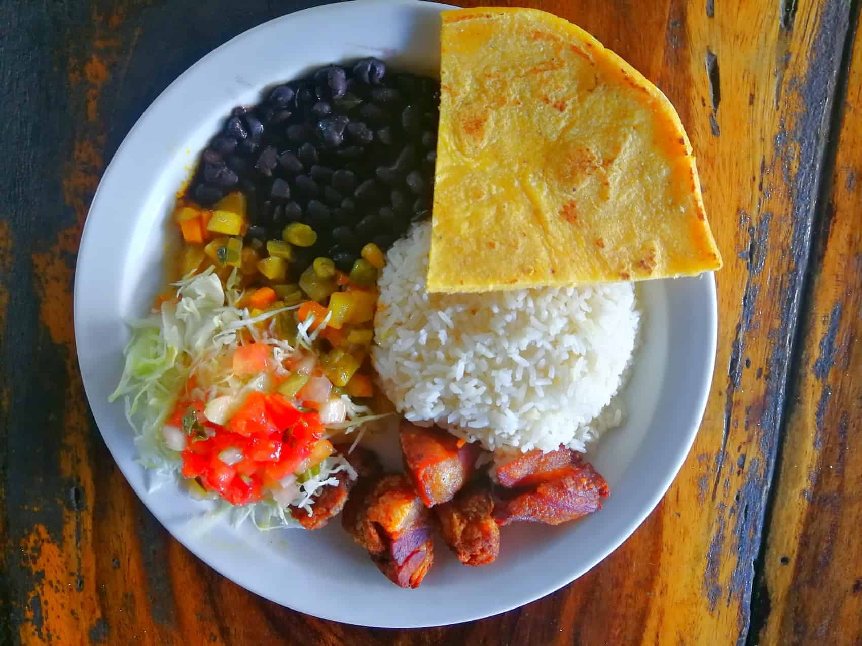 Traditional food in Costa Rica. Rice, beans, salad, tortillas, pork beaf chicken or fish.