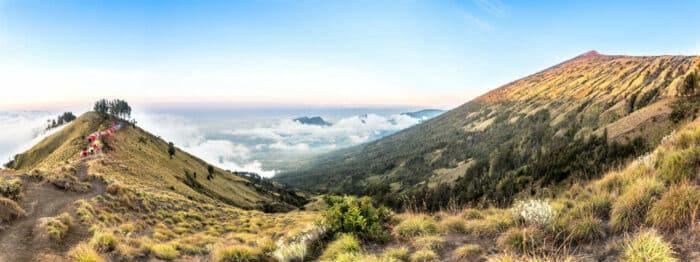 Lombok, Panorama mountain view above the cloud and blue sky. Rinjani mountain, Lombok island, Indonesia