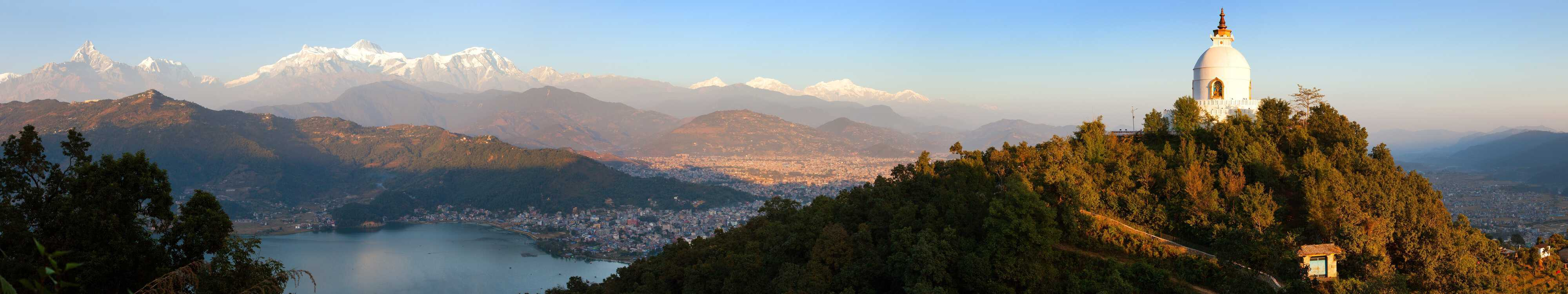 Evening panoramic view of world peace stupa, Phewa lake, Pokhara and great himalayan range, Annapurna, Manaslu, Nepal Himalayas mountains