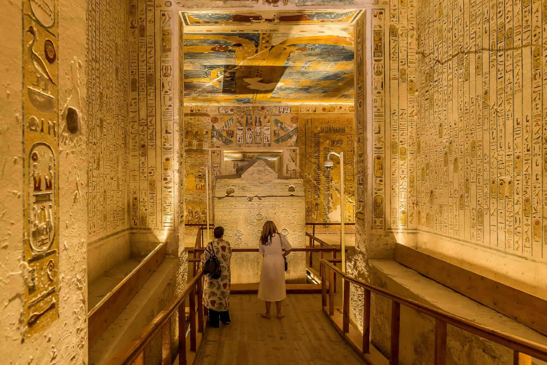 Two turists in the interior of the tomb KV 2 Ramses IV in the valley of the kings, Luxor, Egypt, October 21, 2018