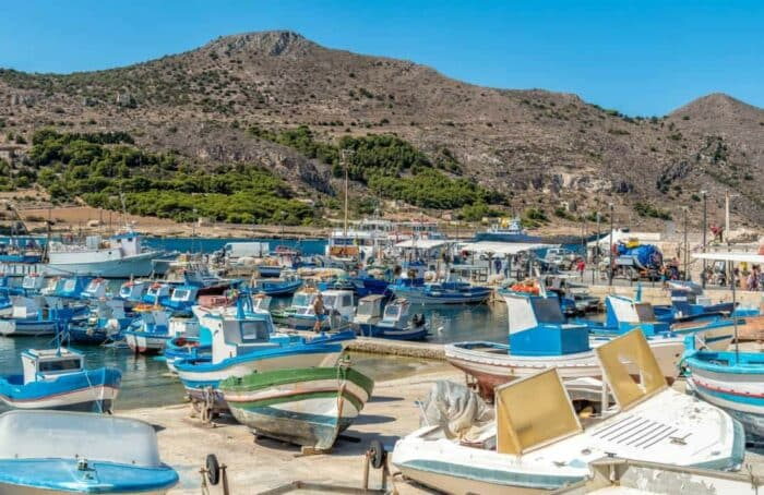 The Port of Favignana island, is the largest of the three Aegadian islands in the Mediterranean sea. Background, blue.