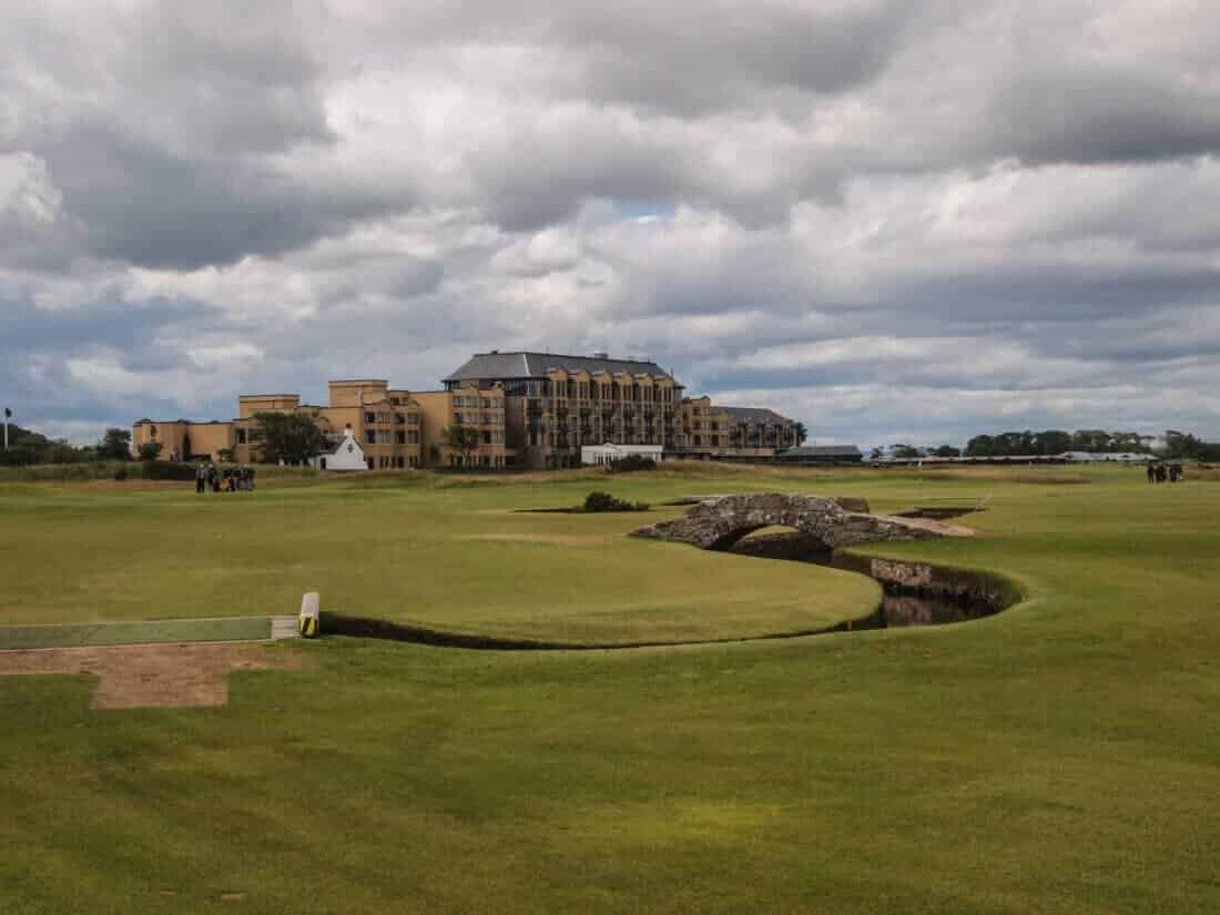 Famous bridge overpass on St Andrews Links Old Course golf course in St Andrews Scotland with Old Course Hotel in background