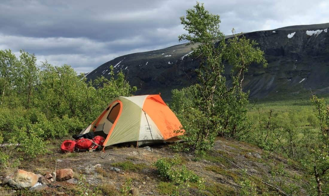 """TCamping Lapland. Kungsleden trail in Sweden. The Kungsleden (""""The King's Trail"""" or """"The Trail of Kings"""") is one of Sweden's most famous hiking trails and runs for a total of 450 kilometres through Swedish Lapland, 200 kilometres north of the Arctic Circle."""