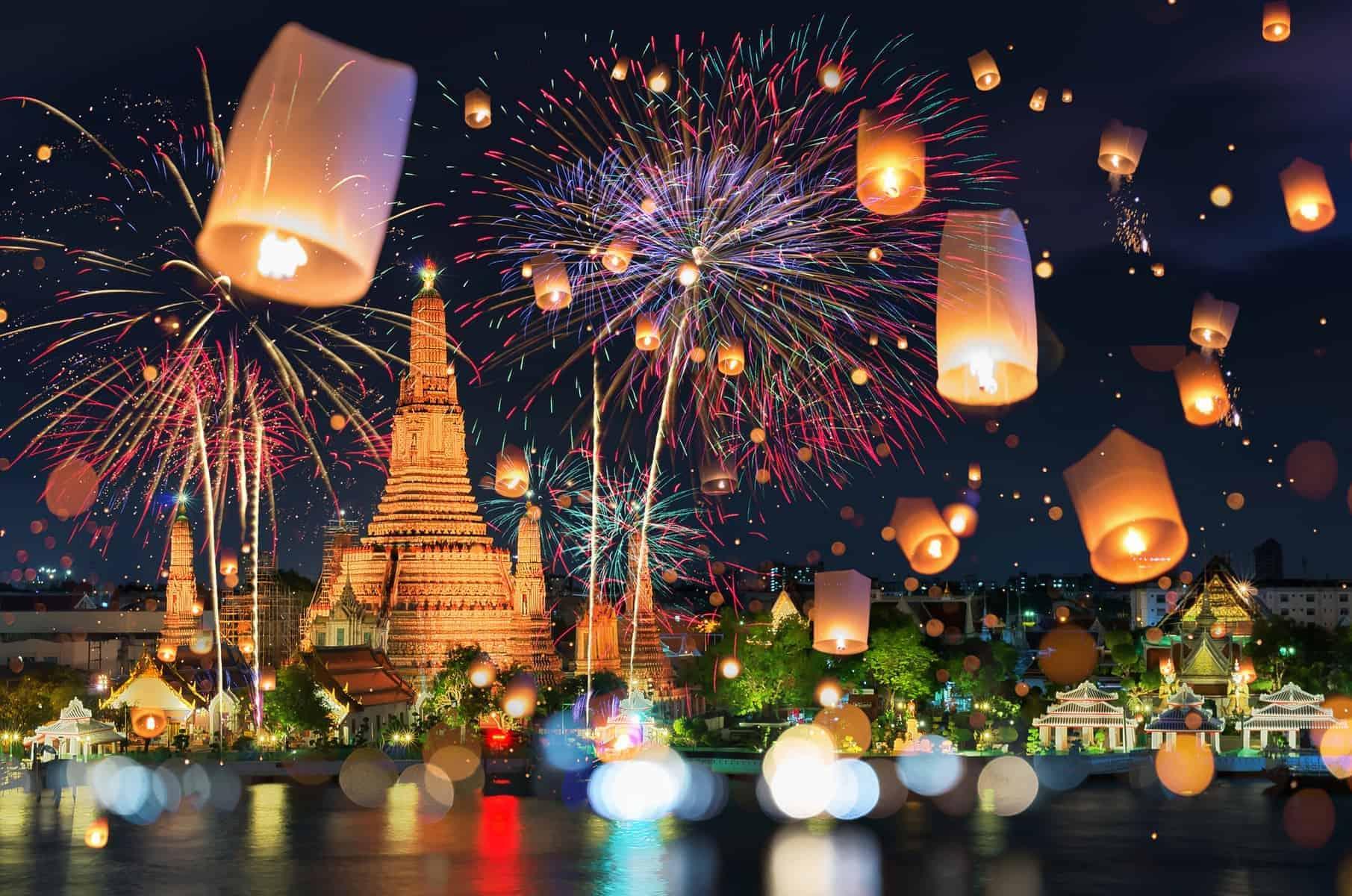 Bangkok happy new year countdown fireworks and lantern at Wat Arun Temple, Bangkok Thailand.