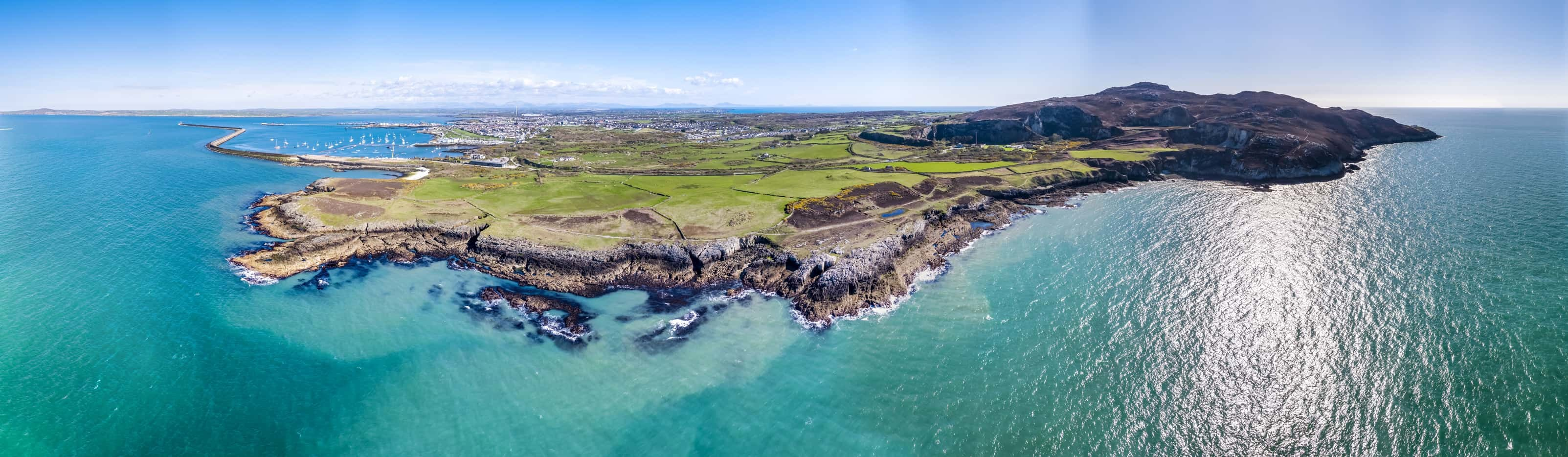 Aerial view of the beautiful coast and cliffs between North Stack Fog station and Holyhead on Anglesey, North wales - UK