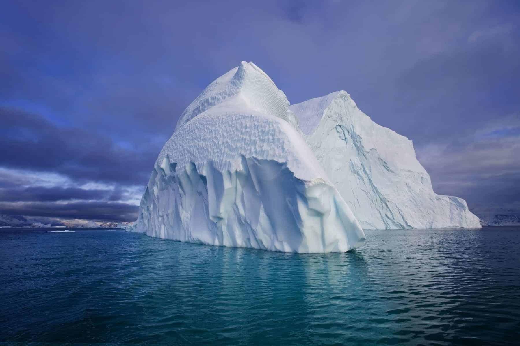 Iceberg in the Iceberg graveyard in Franz Joseph Fjord in eastern Greenland