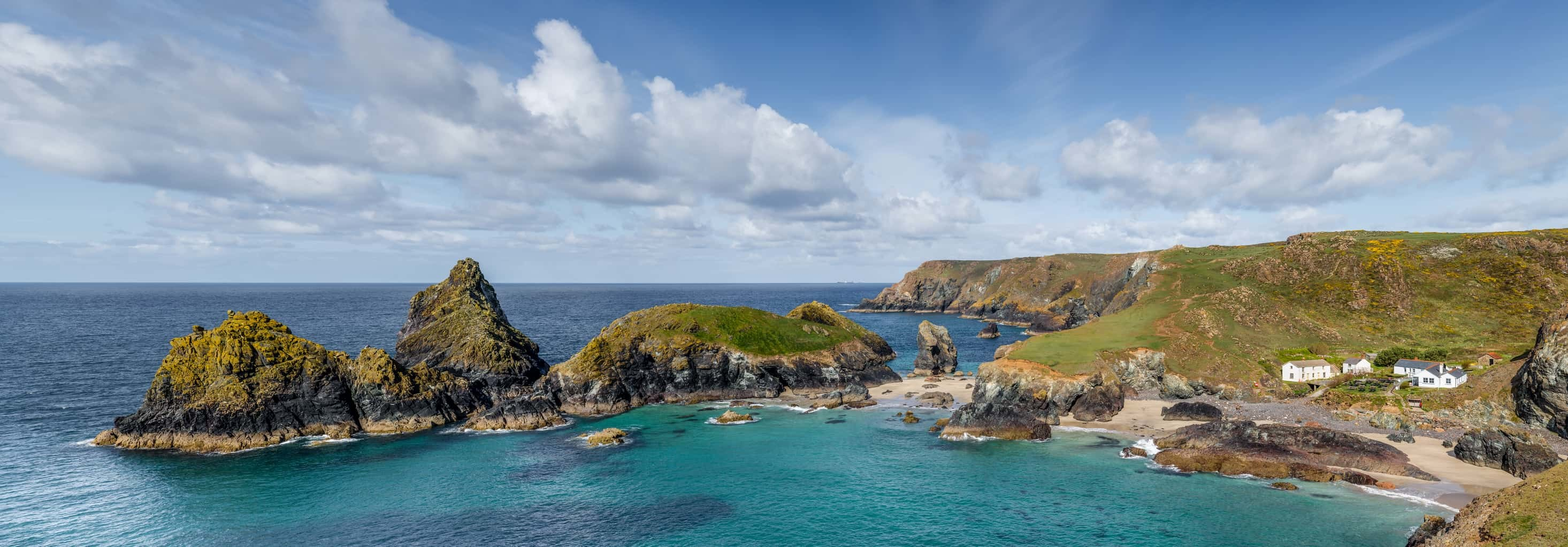 Panoramic photograph of a beautiful Spring day on the west coast of Cornwall at Kynance Cove. UK