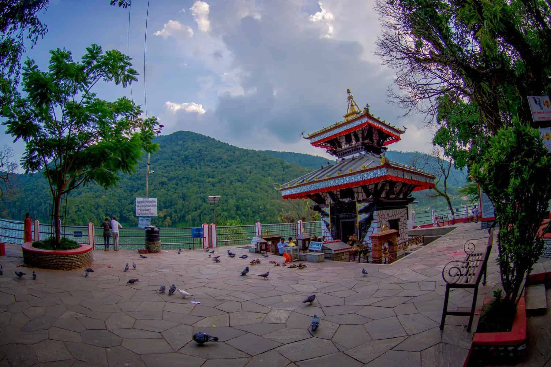 POKHARA, NEPAL -People walking around of Tal Barahi Temple, located at the center of Phewa Lake, is the most important religious monument of Pokhara.
