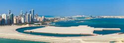 Bird view panorama of Manama city, Bahrain. Skyline with modern skyscrapers standing on the coast of Persian Gulf