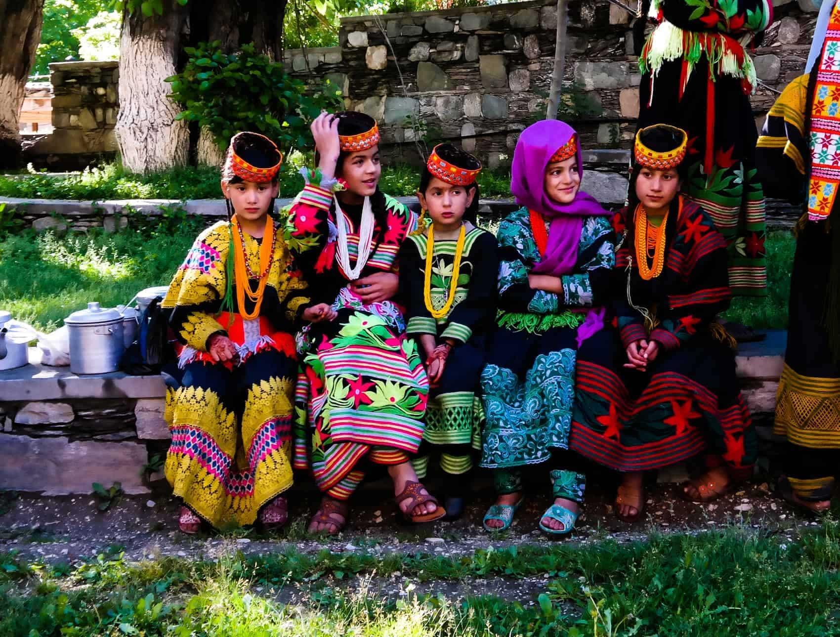 Portrait of Kalash tribe woman in national costume at Joshi fest - 14-05-2015 Bumburet, Kunar, Pakistan