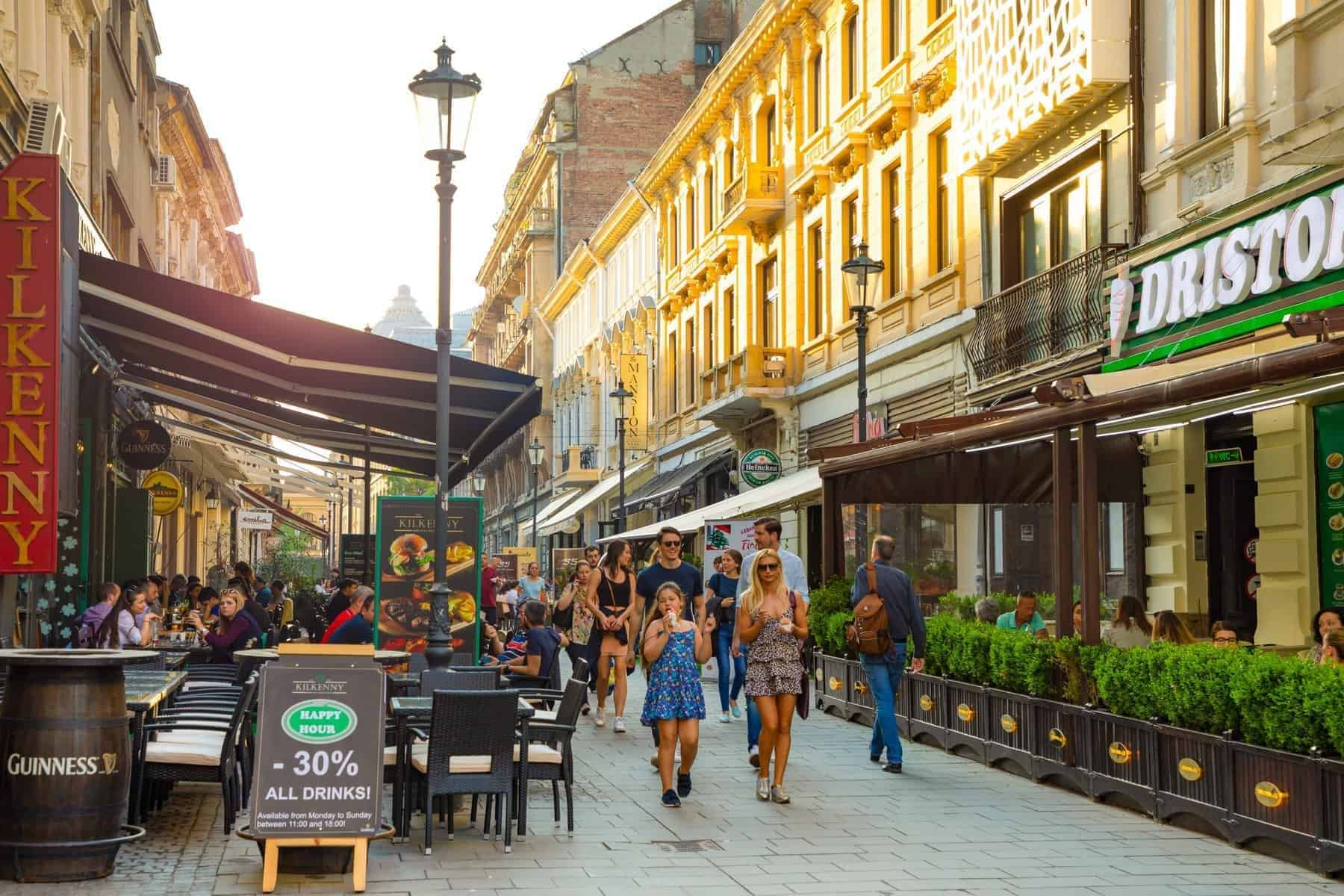 Bucharest, Rumania - 28.04.2018: Tourists in Old Town and Restaurants on Downtown Lipscani Street, one of the most busiest streets of central Bucharest, Rumania
