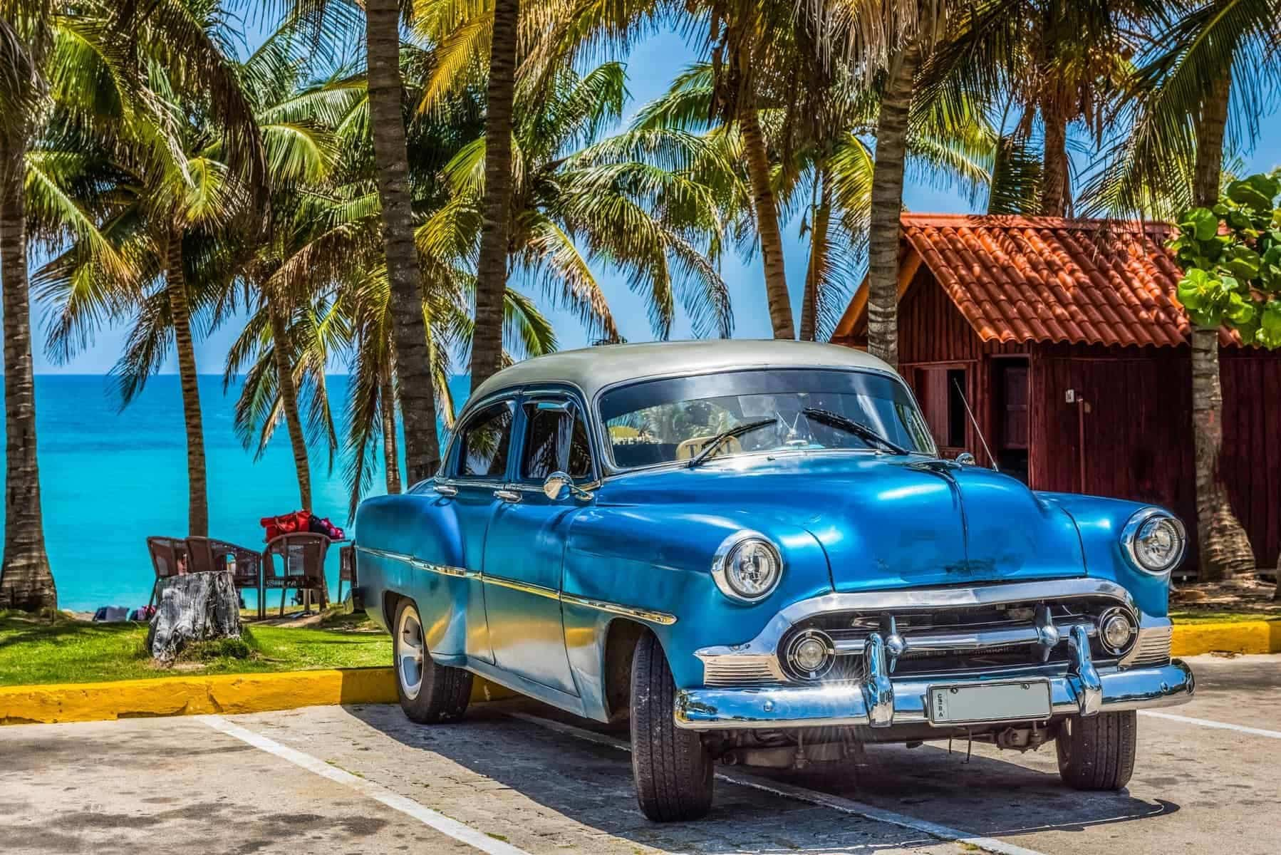 Billeje worldwide: American blue Chevrolet classic car with silver roof parked on the beach in Varadero Cuba