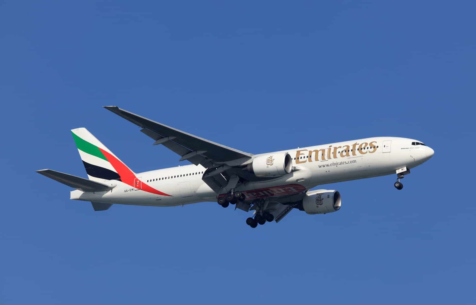 Boeing 777-200 of Emirates Airlines preparing for landing in Doha, Qatar.
