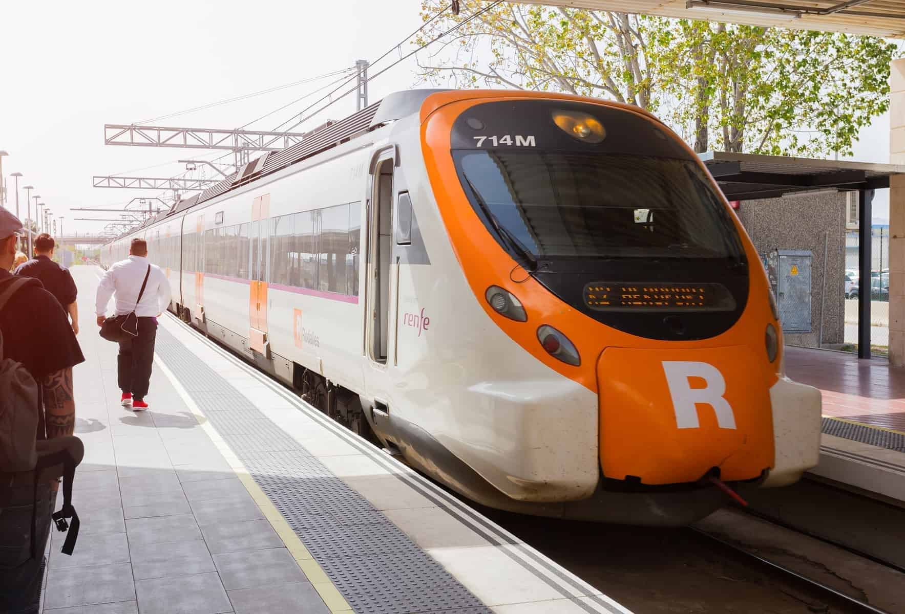BARCELONA, SPAIN - Passengers Board the Renfe train at El Prat airport at the station