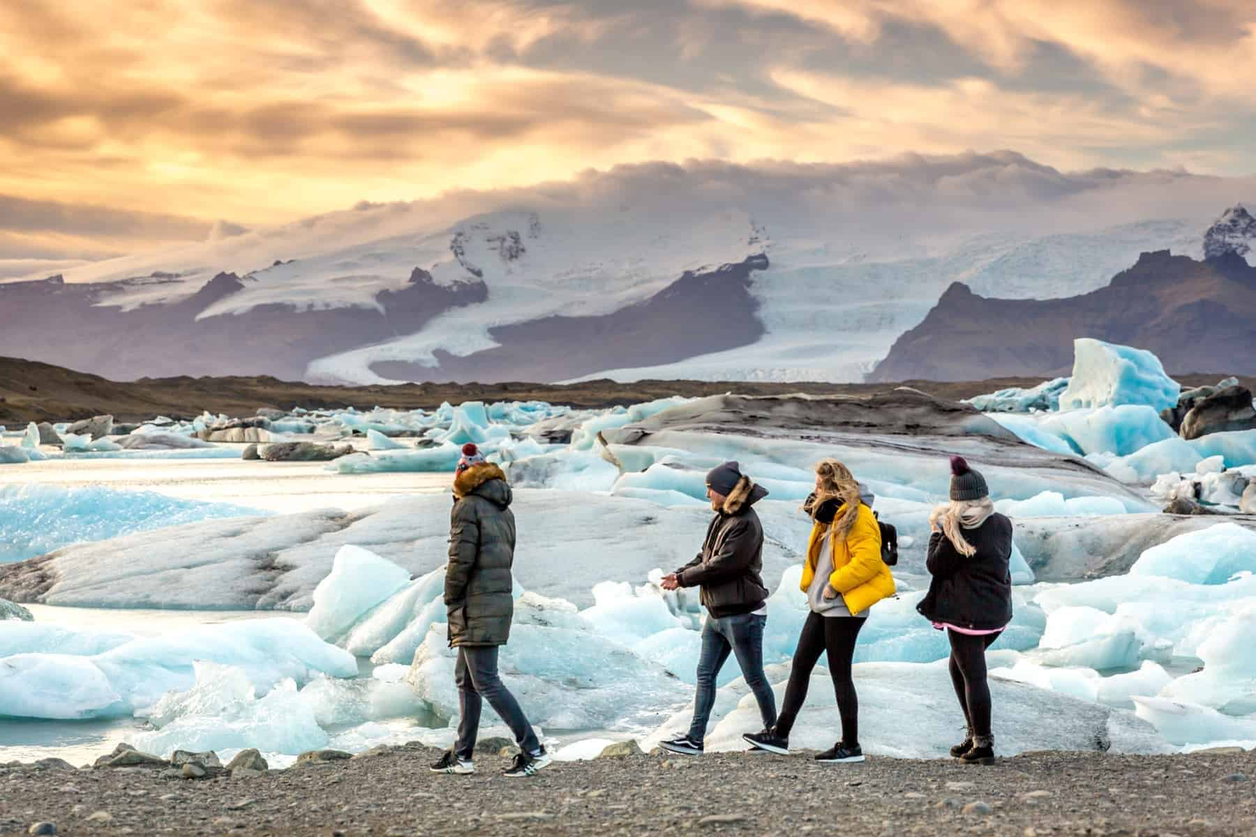 Jökulsárlón, Iceland. Tourists and locals enjoying the Jökulsárlón iceberg lagoon with glacier in the background in Iceland