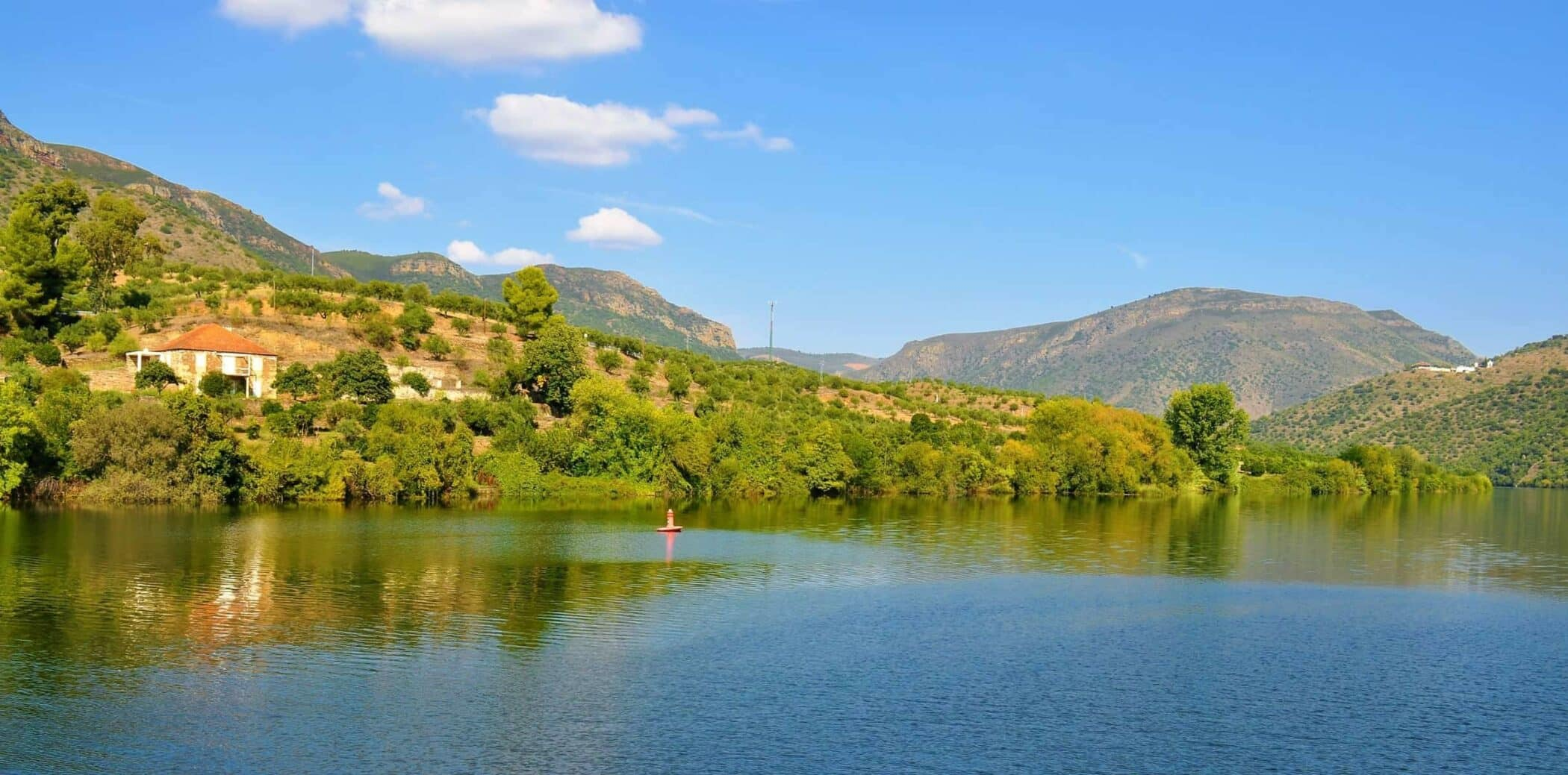 Photo of the river Douro, a house and the blue sky - Trás-os-Montes and Alto Douro Province - Portugal