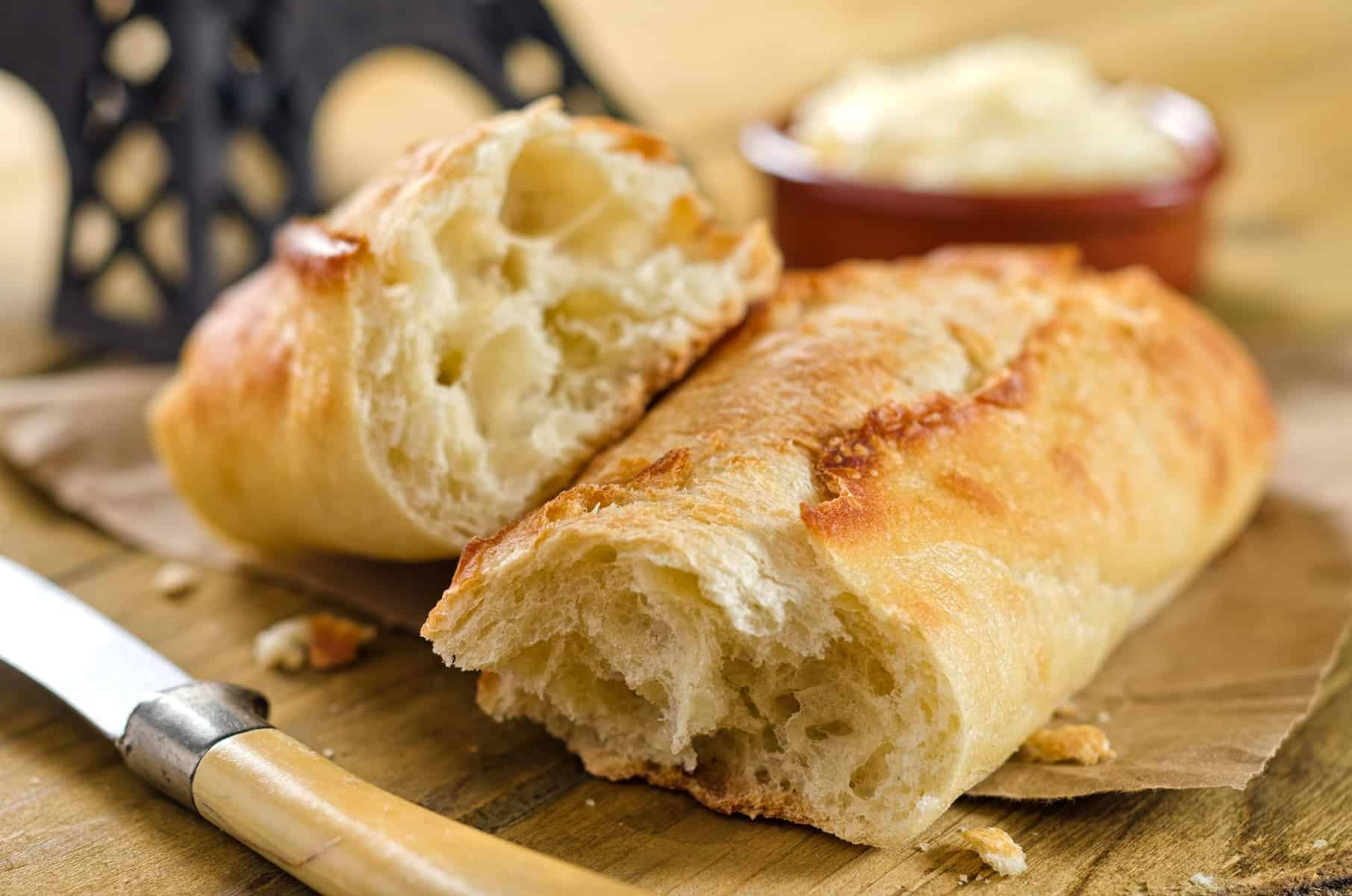 Crisp and chewy french bread baguette with butter.