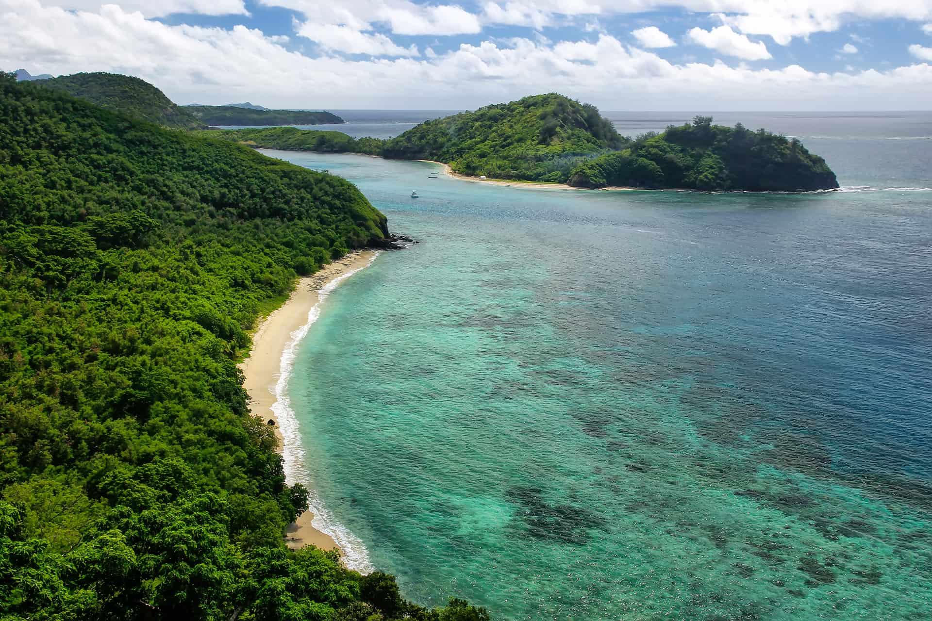 Drawaqa Island coastline and Nanuya Balavu Island, Yasawa Islands, Fiji. This archipelago consists of about 20 volcanic islands